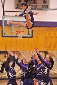 Walt Hester   Trail Gazette Cheerleaders launch their flyer during the Meet the Bobcats on Monday. Cheerleading has come a long way in the last 25 years, requiring the girls to be stronger and more athletic than those of the past.