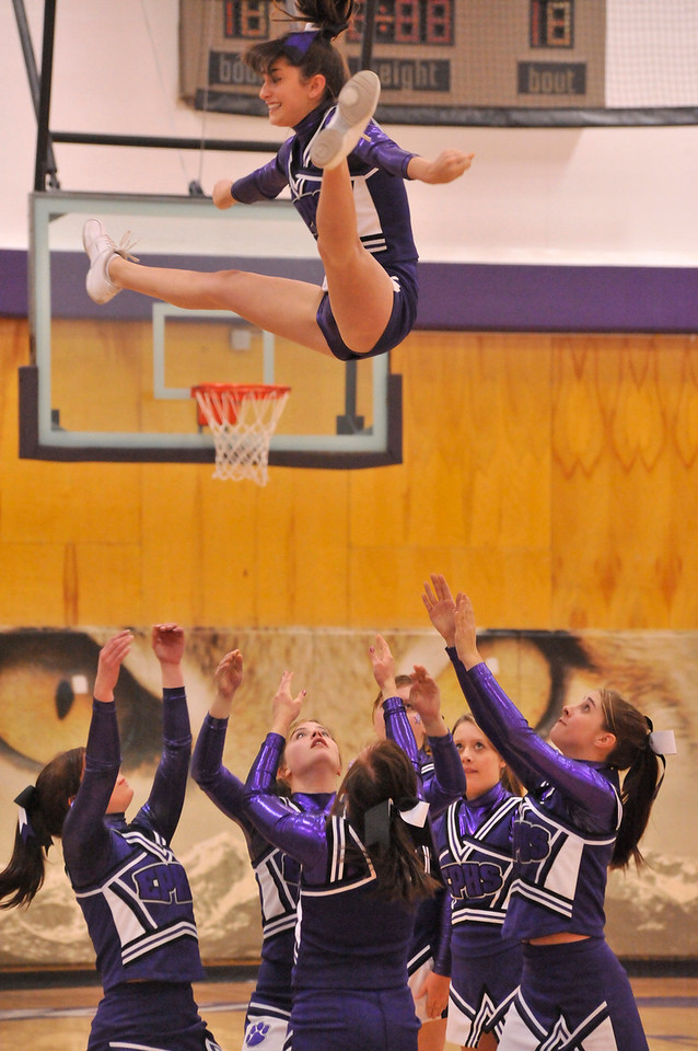 Walt Hester | Trail Gazette<br /> Cheerleaders launch their flyer during the Meet the Bobcats on Monday. Cheerleading has come a long way in the last 25 years, requiring the girls to be stronger and more athletic than those of the past.