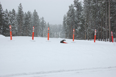 Orange traffic stands block the snowy entrance to Sprague Lake Saturday, Nov. 19. The area is temporarily closed for hazard tree mitigation. The area sufferend numerous downed trees following the Nov. 12 and 13 wind storm that moved through the area.