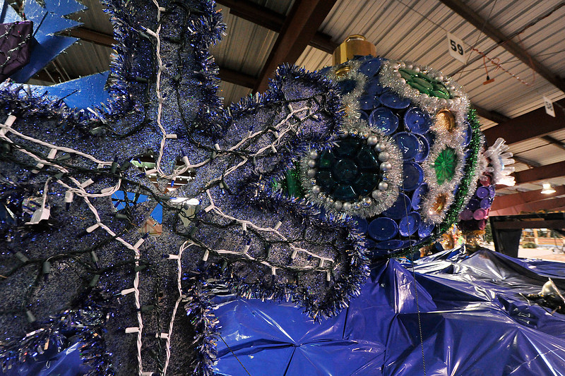 Walt Hester | Trail Gazette<br /> Giant snowflakes and christmas ornaments cover a float. The Catch the Glow parade draws thousands of visitors every year in Estes Park.