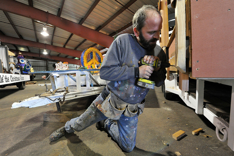 Walt Hester | Trail Gazette<br /> Michael Young assembles one of many floats that appear in the annual Catch the Glow parade. Young works for several weeks ahead of the parade to make sure the floats are in shape for their trip down Elkhorn Avenue on the Friday aftyer Thanksgiving.