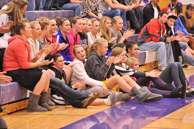Walt Hester   Trail Gazette Estes Park High School Ladycats basketball team chear for fellow athletes at school's Meet the Bobcats night on Monday. The girls have a new coach, far right in orange jacket, and are looking to push themselves as the Ladycats of seasons past have.