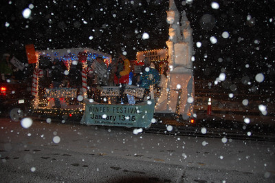 Snow began falling at the start of the 2011 Catch the Glow Christmas pardade, creating an appropriate picture for the Estes Park Winter Festival float.