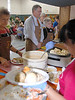 Servers wait for plates during Thursdays 11th annual community Thanksgiving Feast at the Mt. View Bible Fellowship.