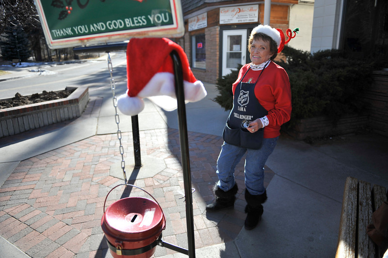 "Walt Hester | Trail Gazette<br /> Sherry Rytting sports a twist on the Santa hat theme while ringing her bell at the Estes Park Post Office on Wednesday. ""If you're going to be crazy enough to ring the bell as often as I do, you got to wear a crazy hat."""