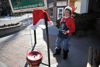 "Walt Hester | Trail Gazette Sherry Rytting sports a twist on the Santa hat theme while ringing her bell at the Estes Park Post Office on Wednesday. ""If you're going to be crazy enough to ring the bell as often as I do, you got to wear a crazy hat."""