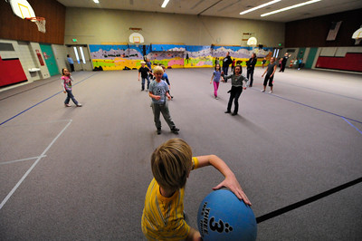 "Walt Hester | Trail Gazette Children play ""Ultimate Basketball"" after school on Monday. The game involves a three-pound medicine ball, low hoops and lots of energy."