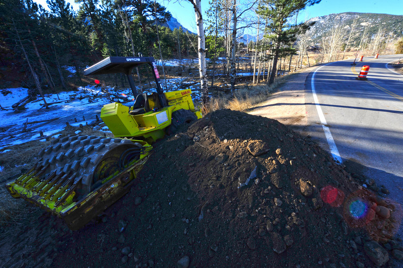 Walt Hester | Trail Gazette<br /> Heavy equipment and fill dirt sit next to the beaver ponds along Fish Creek Road on Tuesday. Crews will begin work linking the west portion of the trail with the section from the south and east.
