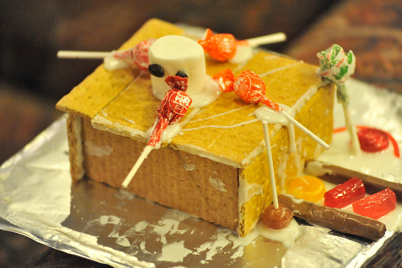 Walt Hester | Trail Gazette<br /> Graham crackers substitute for ginger bread at a decorating class earlier in November. The holiday treat is so popular that the Catch the Glow Parade featured a float with a giant ginger bread house.