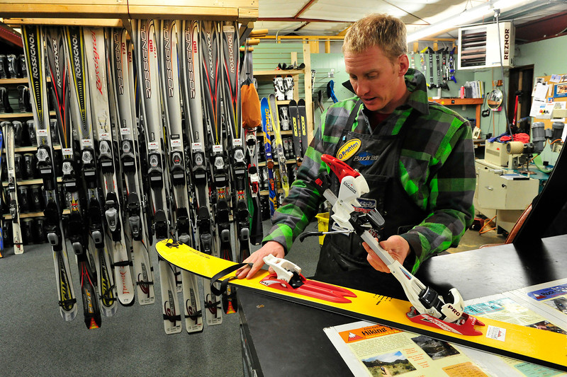 Walt Hester | Trail Gazette<br /> Zach Zehr of the Estes Park Mountain Shop demonstrates a backcountry touing ski binding. The Mountain Shop will be offering a backcountry package, as well as classes on enjoying the backcountry safely.
