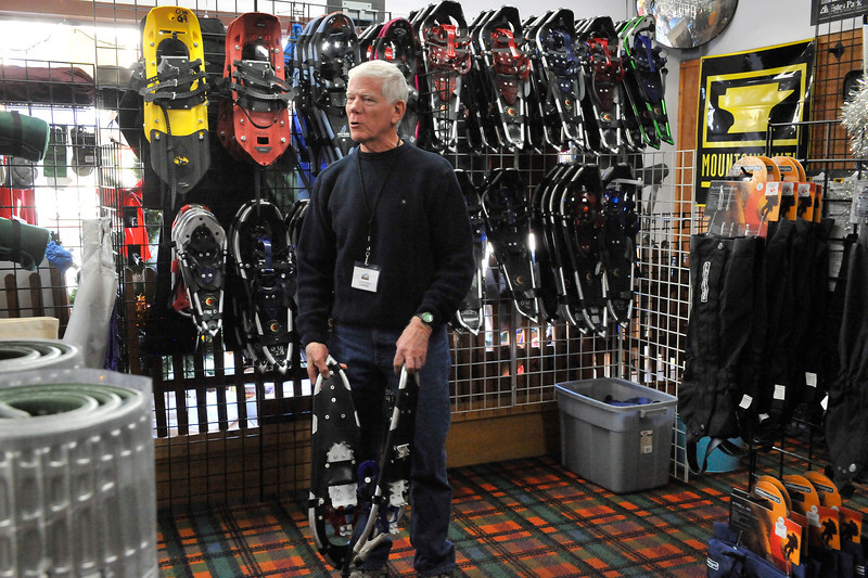 Walt Hester | Trail Gazette<br /> CHarlie Boleman of Outdoor World talks snowshoes with a manufacturing rep on Wednesday. Boleman has been helping outdoor enthusiasts and novices enjoy the outdoors for 35 years.