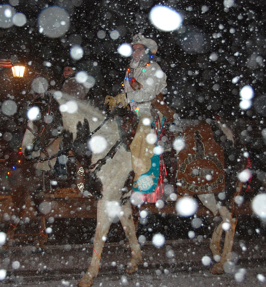 Rooftop Rodeo royalty is underneath all the snow at the 2011 Catch the Glow Christmas Parade in Estes Park.