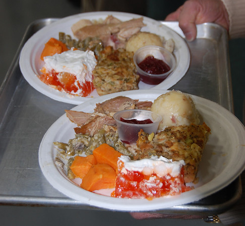 Dinner at the 11th annual Community Thanksgiving Feast included turkey, sweet potatoes, dressing, cranberry sauce, mashed potatoes and dessert.