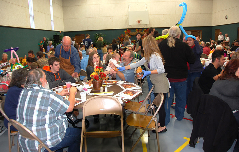 The annual Community Thanksgiving Feast attracted a large number of diners, with the gym area of the Mountain View Bible Fellowship quickly filling up after the doors opened at 11:30. This is the 11th year for the annual community feast.