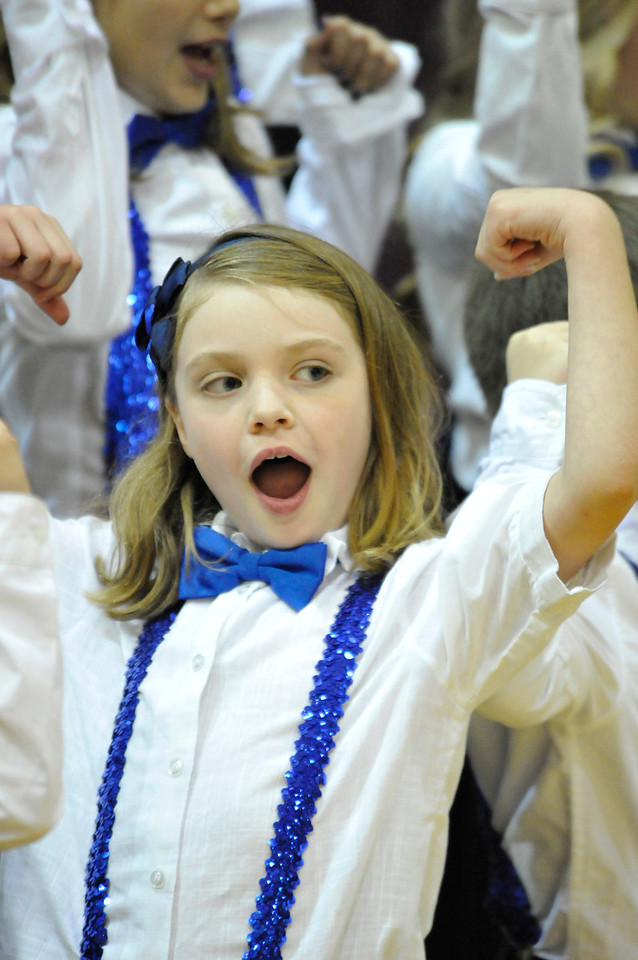 Walt Hester   Trail Gazette<br /> Eight-year-old Madison Moellers flexes her voice as well as muscle during the Mountain Echoes' annual holiday concert at the Estes Park Elementary School on Tuesday. The choir of 3rd-5th-grade begins rehersing in September for their annual December show.