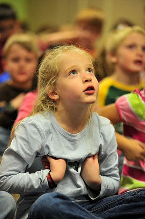 Walt Hester | Trail-Gazette<br /> Estes Park firsty-grader Paige Barker and classmates sing about the Albuquerque Turkey at the Estes Park Elementary School on Tuesday. The first grade ended their last day before break with a fun sing-along to get in the Thanksgiving spirit.