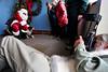 Walt Hester   Trail-Gazette<br /> Photographer Kent Dannen lies down to shoot Santa and an Australian sheepdog named Emily at the annual Pet Association event on Saturday.