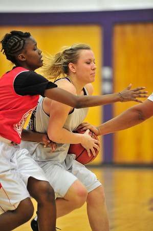 Walt Hester | Trail-Gazette<br /> Senior Kyra Stark runs into the teeth of the Denver East defense on Saturday. The Ladycats invited teams from larger Front Range schools to challange them before the start of their 2010-'11 campaign.