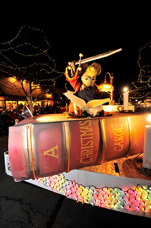 Walt Hester   Trail-Gazette<br /> The Nutcracker's mouse king brandishes his sword from atop a huge copy of Dickins' A Christmas Carol. The float is not new, but a favorite with several characters from the famous Christmas story.