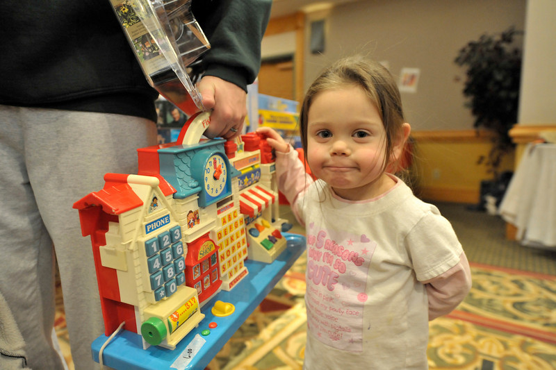 Walt Hester | Trail-Gazette<br /> Jade Ertl, 3, seems proud on Saturday of her find at the annual Holiday House fund raiser for the Elizabeth Guild. Volunteers and shoppers alike report wall-to-wall shoppers at the event held at the Estes Park Conference Center.