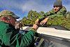 Walt Hester | Trail-Gazette<br /> Estes Park Mayor Bill Pinkham straps a Christmas tree to his car with the help of boy scout Sean Cody, 16, at the Boy Scouts Christmas Tree Lot on Saturday. The scouts will sell trees through the holiday to help fund their troop and their projects.