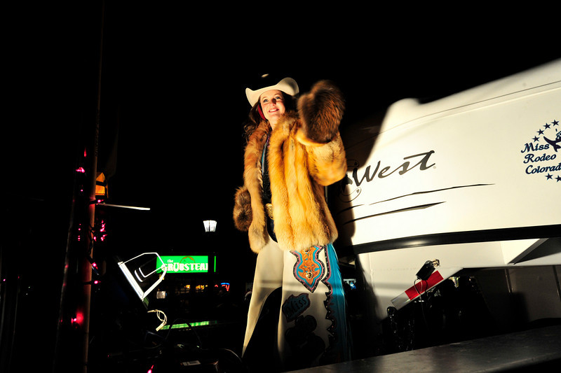 Walt Hester | Trail-Gazette<br /> Kellsie Purdy waves to crowds lining Elkhorn Avenue during Friday's annual Catch the Glow Parade. Purdy is the only Miss Rodeo Colorado from Estes Park.