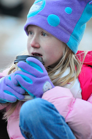 Walt Hester | Trail-Gazette<br /> Ivy Corbett, 9, of Smith Center, Kan. enjoys some hot cocoa on a chilly Friday afternoon. Hot drinks were the hot commodity before Friday's Catch the Glow parade.