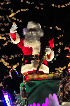 Walt Hester | Trail-Gazette<br /> The parade's most famous spirit, St. Nick, waves to the crowd at the end of the Catch the Glow Parade. The 40-plus-float parade attracted visitors from all along the front range and vacationers from far and wide.