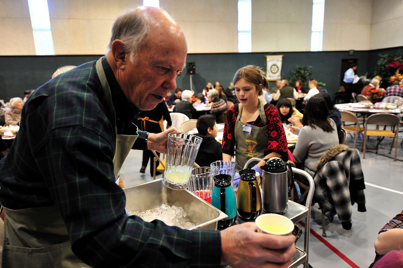 Walt Hester | Trail-Gazette<br /> Estes Park mayor Bill Pinkham serves the public at te annual free Thanksgiving feast at the Mountain View Bible Fellowship on Thursday. This was the tenth year of the free community meal.
