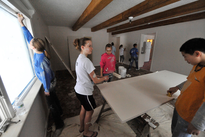 Walt Hester | Trail Gazette<br /> Members of the Estes Park Middle School's Builders Club paint town housing on Sunday. The group regularly performs community service around Estes Park.