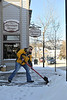 Walt Hester | Trail Gazette<br /> Elizabeth Dunnhardt shovels the walk along Elkhorn Avenue on Monday. More sunshine and less snow is in this week's forecast.