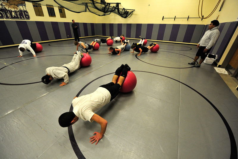 Walt Hester | Trail Gazette<br /> The Bobcats wrestlers perform pushups on fitness balls during their Wednesday workout. The boys placed 3rd among 3A teams.