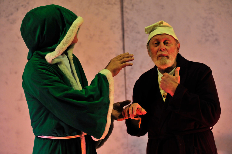 Walt Hester | Trail Gazette<br /> The Ghost of Christmas Past, Mark Edwards, shows Scrooge visions of a happier time. This is Edwards' first production with the EPRTC.
