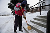 Walt Hester | Trail Gazette<br /> Don Holmes of Estes Park sweeps the stairs at the Mount Calvary Lutheran Church on Saturday ahead of the church's annual holiday bazaar. Many people braved the cold and snow to enjoy the treats found at the annual event.