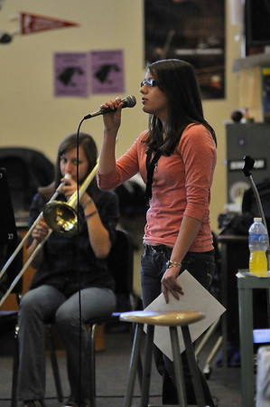 Walt Hester | Trail Gazette<br /> Jennifer Klink belts out Christmas tunes as the Estes Park High School band practices for Monday's holiday concert. The annual event is held at the high school's auditorium beginning at 7p.m.