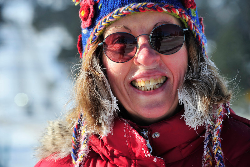 Walt Hester | Trail Gazette<br /> Ellie Harris of Estes Park flashes a frosty smile, and hair and coat, while out walking along South St. Vrain Avenue on Monday. Thermometers read as low as 10 below zero Monday morning.