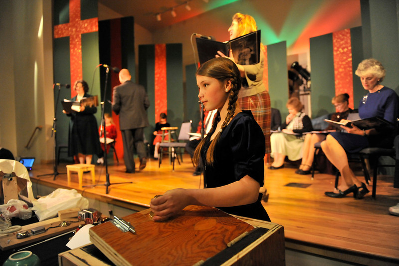 Walt Hester | Trail Gazette<br /> Skylar Shumate awaits her cue at the sound effects table during Wednesday's rehearsal of Miracle on 34th Street. The play is being staged as a '40s-era radio play.