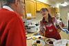 Walt Hester | Trail Gazette<br /> Nancy Hughes of Estes Park talks with a visitor to the annual Mount Calvary Lutheran Church Holiday Bazaar. The bazaar featured lots of hoemade treats, as well as their lunchen featuring their famous krautburgers.