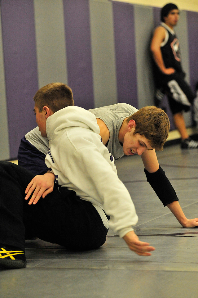 Walt Hester   Trail Gazette<br /> Will Casey sits out against Cole Woodard in practice on Wednesday. The grapplers both placed this weekend's tournament at Middle Park High School.