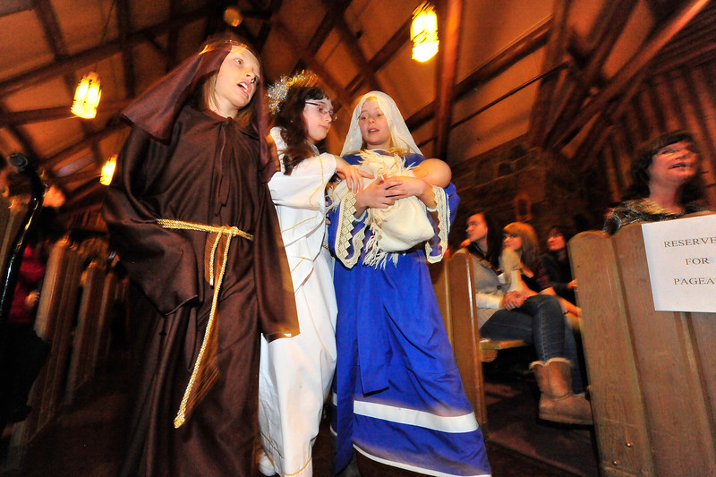 Walt Hester | Trail Gazette<br /> Joseph, Finnian Tomasula-Martin, the lead angel, Megan Miller, and Mary, Camdyn Arnold, lead the cast of Our Lady of the Mountains Catholic Church's annual Christmas Pagent on Sunday. Saints, angels and an innkeeper told the story of the Nativity during the annual pagent.