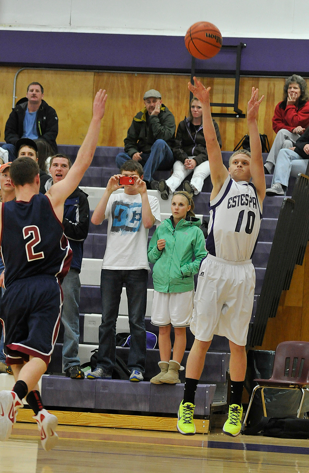 Walt Hester   Trail Gazette<br /> Taylor Marshall tosses up and knocks down one of three three-pointers from Thrursday's win over Frontier Academy. Marshall has helped guid the Bobcats to two stratght victories before the winter break.
