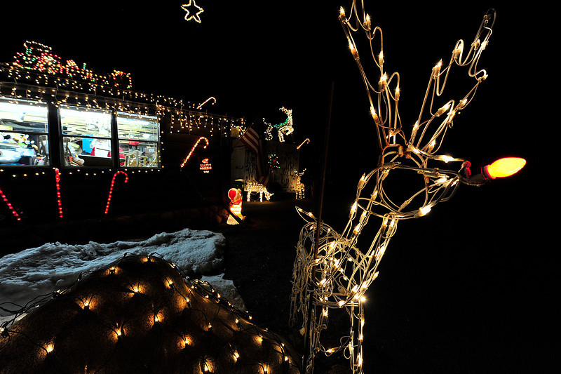 Walt Hester | Trail Gazette<br /> Reindeer, candy canes, trains and much more decorate the little workshop at the corner of West Riverside and Crags on Monday.