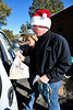 Walt Hester | Trail Gazette<br /> Brad Doggett and Susan Speedlin help load up a car at the annual Bright Christmas distribution on Wednesday. 131 families will enjoy the generousity of the event this year.