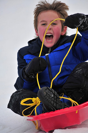 Walt Hester | Trail Gazette<br /> Austin Tice, 9, literally screams down the sledding hill at the YMCA of the Rockies on Wednesday. Now snow and plenty of hills give sledding enthusiasts plenty of terrain to choose from.
