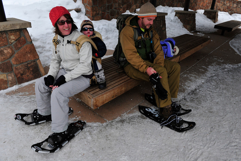 Walt Hester | Trail Gazette<br /> The Parsons family of Longmont, Suzi, Asher,2, Steve and Amelia, 5, finish up their snowshoe hike at Bear Lake on Wednesday. With packed trails and plenty of new snow, snowshoing in the national park should draw plenty of families outdoors.