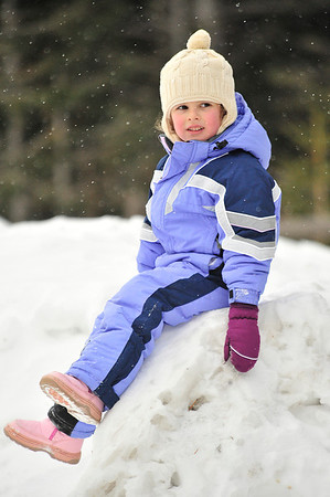 Walt Hester | Trail Gazette<br /> Amelia Parsons, 5, awaits her parents as snow slowly falls at Bear Lake on Wednesday. A winter storm rolled in to the Estes Park area on Wednesday afternoon and dumped five to eight inches of new snow around the area and more in higher elevations, like the national park.