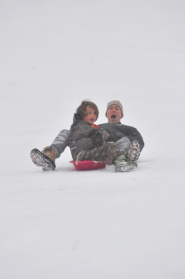Walt Hester | Trail Gazette<br /> Shawn Preston and son Jake, 7, scream down the sledding hill at Hidden Valley on Monday. Snow may return on Thursday, but the weekend should be sunny.