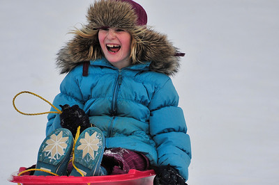 Walt Hester | Trail Gazette Anna Greenway races down a sledding hill near the YMCA of the Rockies on Wednesday. With five inches of new snow in the middle of the winter break, children will have plenty to smile about.