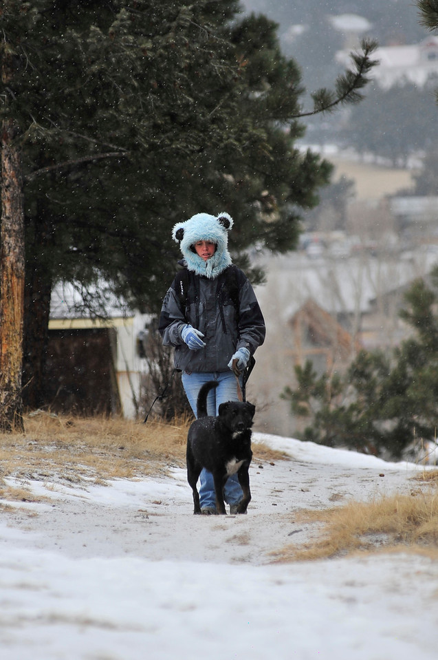 Walt Hester | Trail Gazette<br /> Katie Stuchel and companion Marley walk along St. Vrain Avenue during Monday's snowfall. While clear and sunny, temperatures will cold, low 30s Wednesday, teens and 20s the rest of the week.