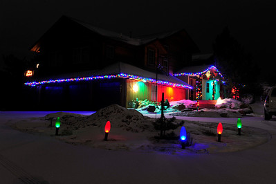 Walt Hester | Trail Gazette A colorful home lights the evening near the corner of Bighorn and Spruce Drives.